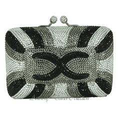 This Anthony David black, pewter gray and clear crystal evening bag has a solid brass metal frame with a silver plated finish. It is fully covered with Swarovski crystals and the interior is lined ...