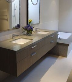 Contemporary bathroom with two symmetrical mirrors and undermount sinks