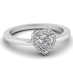 This alluring halo #engagementring showcases a prong set heart shaped diamond as the center stone that is encircled by a string of round cut #diamonds and gemstones in prong setting. http://jangmijewelry.com/