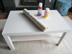 A 20 dollar IKEA plain white coffee table...pick your wallpaper print, spray adhesive to get it to stick...apply mod podge and spray shellac over the wallpaper as a protective coating...and lastly, add decorative nails as a border...and BAM.