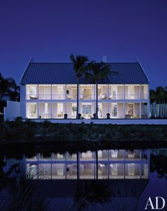 A home in a Florida resort town has a symmetrical plantation-house aesthetic.