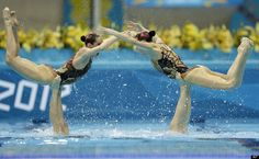 The team of Russia and winner of the gold medal competes during the women's team synchronized swimming free routine at the Aquatics Centre in the Olympic Park during the 2012 Summer Olympics in London, Friday, Aug. 10, 2012.