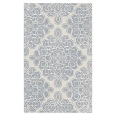Wool rug with a scrolling tile motif. Hand-tufted in India.   Product: RugConstruction Material: Wool