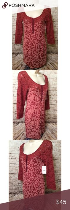 Free People Rust Copper Lace embellished dress Really pretty.  Perfect condition. Sz small but stretchy.  New with tags.  MSRP $93.  Tag marked to prevent returns.  Approximate Measurements lying flat:   Chest (armpit to armpit): 15 inches Length (shoulder to hem): 31 inches   Smoke free home. Free People Dresses Mini