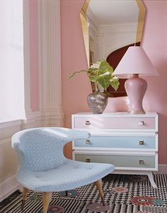 Diamond Baratta designed the boomerang chair, lacquered chest, and mirror.