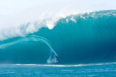 The wave is so much larger than the surfer, but they are still riding it despite the scale. It seems so scary and could kill you if you're not careful but that surfer enjoys that so much, it's worth the risk.