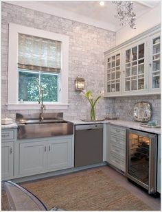 Beautiful subway tile backsplash in marble.