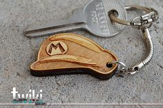 Laser cut and engraved Mario Bros Hat wood keyring. By TwikiConcept on Etsy