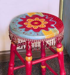 Colorful Boho Stool -- Create a colorful boho stool with beaded fringe. #boho #decoartprojects #chalkyfinish