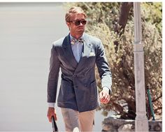 This blue double breasted jacket, pairs effortlessly with tan cargos and a linen bow tie for a casual spring look. Finish your look in style with a light blue shirt and matching pocket square.