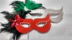 DIY masquerade mask using glitter papers, feather and sequins