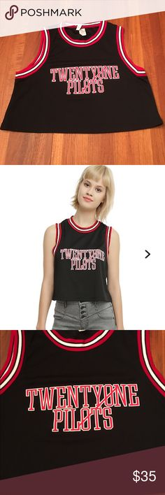 Hot Topic Twenty One Pilots Girls Jersey Tank Top Black athletic inspired jersey style crop tank top from Twenty One Pilots with a red & white logo design on front and red, white & black ribbed trim. New without tags and sold out everywhere. 100% polyester Hot Topic Tops Crop Tops