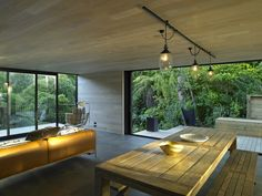 Blending With The Landscape: The Waiatarua House in New Zealand