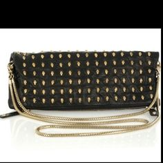 Black leather fold-over clutch with all-over gold-tone skull studs. Thomas Wylde bag has a two varying sized detachable gold-tone chain handles, a concealed magnetic stud and zip to fasten, an internal zipped compartment and is fully lined. Studded Clutch, Foldover Clutch, Thomas Wylde, Alexander Mcqueen Dresses, Tough As Nails, Betsey Johnson, Purses And Bags, Zip Around Wallet, Christian Louboutin