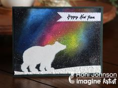Ink Stains - a fun twist on the Northern Lights Technique using VersaFine Clair & Sparkle Embossing Powder - really adds a punch to create the starry night sky! #Imagine #imaginecrafts #versafineclair #embossing #northernlights #inkstainedroni #cardmaking #rubberstamping #radiantneonamplify #happynewyear #polarbear #handcarvedstamp