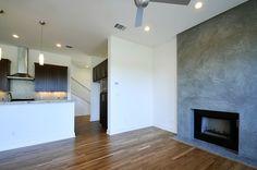 Lund St. duplex by Riverside Homes | Living Room | Concrete Fireplace | Modern design | homebuilder in Austin, TX