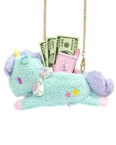 Plush unicorn purse for you to hide your precious stuff. | 27 Magical Unicorn Pieces You'll Want In Your Closet