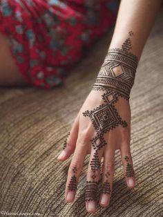 Geometric Mehndi Hand Tattoo