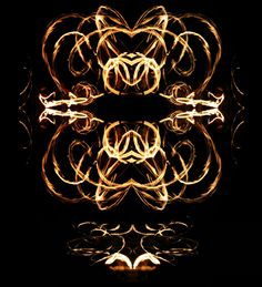 fire poi- this is insane, I love the mirroring of the water...absolutely gorgeous!