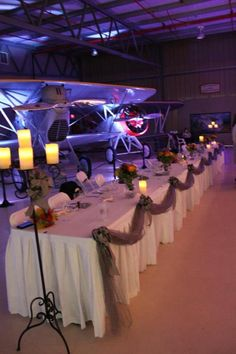 This airplane themed wedding got a bit of oomph with our lights highlighting the plane! Uplight cars, pillars, stages, art features, and more!Who says our lights are just for receptions? This DIY bride used our blue and pink lights to create a dramatic cermony space. #diyuplighting