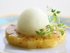 Keep things simple with this Roasted Pineapple with Thyme-Ginger Ice: caramelized, roasted pineapple slices get a scoop of ginger ice and a sprig of fresh thyme.
