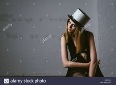Stock Photo - Portrait of female fashion model wearing hat made of drum parts -    away, beauty, blond, blonde, cloth, couture, cymbal, cymbals, dress, drum, drums, extravagant, fashion, hat, haute, haute-couture, high, horizontal, inside, instruments, looking, model, music, people, photo, portrait, posing, pretty, serious, set, shoot, shooting, shot, sitting, studio, style, stylish, trendy, up, urs siedentop, woman