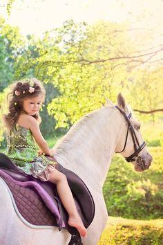 A little beauty riding a beautiful horse~