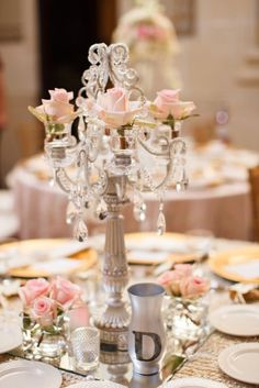 Wedding table decor using candelabras created by Opulent Treasures See more here: http://www.opulenttreasures.com/shop/blossom-4-taper-candelabra