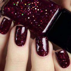Dark red gliiter nail design