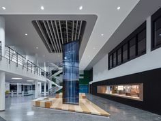 Scope Architekten used solid-surfacing for the custom bench and precast concrete for the display panels of a gallery in the training center at SAP's campus in Walldorf, Ge...