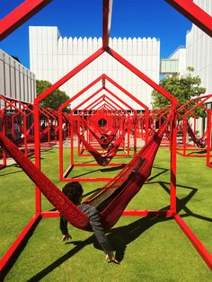 """Mi Casa, Your Casa"" made for the Woodruff Arts Center in Atlanta as part of a two-year initiative meant to activate the Woodruff's centrally located Sifly Piazza. It's comprised of 40 red, metallic house-shaped frames which function as a versatile, three dimensional canvas readily applicable to a variety of creative and relaxing uses."