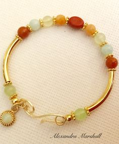 You will enjoy this multi gemstone memory wire bracelet by Alexandra Marshall with both casual and dressy attire. Permanently sealed 18K gold over brass and handmade clasp (not necessary with memory wire, but nice for extra security) with Aquamarine, Aventurine, Jade, Jasper, and Quartzite. #B2591