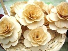 "These flowers are made of ""Birch Wood"" shavings that are shaped and beautifully crafted.Comes in natural color."