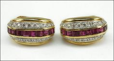 A PAIR OF RUBY, DIAMOND, AND 18 KARAT YELLOW GOLD EARCLIPS. Lot 150-7189 #jewelry