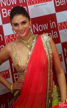 Looking luscious in a fruity peach and green lehenga ensemble by Manish Malhotra, was actress Aditi Rao Hydari, who launched P. Bollywood Actress Hot Photos, Beautiful Bollywood Actress, Most Beautiful Indian Actress, Beautiful Actresses, Actress Pics, Bollywood Dress, Bollywood Wedding, Indian Celebrities, Bollywood Celebrities