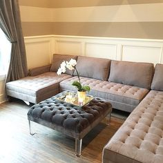 @kathrynclairejessogne's living room is really coming together! Styled with our Vapor Sectional and Eliot Ottoman.