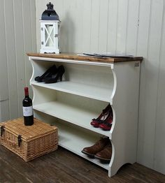 A hallway shoe rack or bookcase with three storage shelves - An eye catching, solid and substantial shoe bench with lots of storage room - Get shoes off the floor and out of the way - An attractive addition to any hallway, entryway, cloakroom or bedroom - Solid wood with no assembly