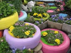 Using old tires...a flower bed or fill with sand for a sandbox. Very neat idea, love the colors but I like the idea of keeping the tires all natural too!