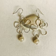 Made a pair of Hawaii Silver Wire Plumeria Earrings with freshwater pearls!