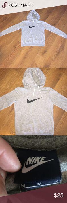Nike hooded sweatshirt. Good condition. Grey Nike hooded sweatshirt. Size medium boys. Would fit a women's small. Nike Tops Sweatshirts & Hoodies