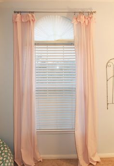 Covering Arched Windows, how to cover arched windows with a cost effective shade...under $6!! Theraggedwren.blogspot.com