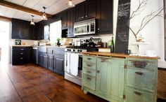 One Color Fits Most: Black Kitchen Cabinets with antique green buffet