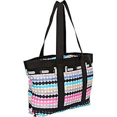 Good carry-on, weekender, or beach trip bag for casual travel.  Medium Travel Tote Roller Girl