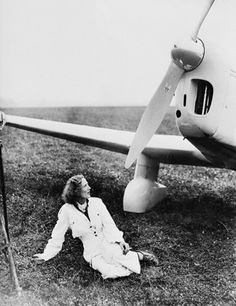 Pilot Beryl Markham, posing for photographer at Abingdon Aerodrome, Berkshire, prior to take off for her solo flight across the Atlantic on Sep.