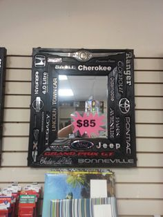 Car emblems inset in a wooden framed mirror. A perfect gift for a car lover, looks great in any man cave! Now on sale at Pack & Mail! www.packandmailny.com