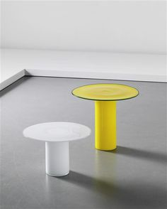 VISTOSI  Two rare side tables, 1980s  Coloured glass, opaque glass.  Produced by Vistosi, Italy (2).  Largest: 46.3 cm (18 1/4 in) high, 53.3 cm (20 7/8 in) diameter; smaller: 31.5 cm (12 3/8 in) high, 50 cm (19 5/8 in) diameter
