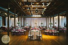 Pink and lace with pops of teal for a wedding reception at The Cotton Room in Durham, NC #TriangleWeddings (photo courtesy of Vesic Photography)