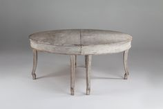 A pair of Gustavian style carved and painted wood demi-lune console tables together forming a circular dining table, concave legs, white washed paint finish; available in other sizes and a range of finishes, from £4500