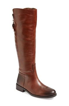 Free shipping and returns on Vince Camuto 'Kadia' Riding Boot (Women) at Nordstrom.com. A casually looped belt cinches the split back shaft of a burnished leather riding boot set on a stacked heel.