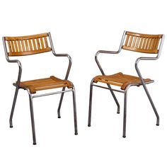 Pair of Italian Modernist Armchairs   From a unique collection of antique and modern armchairs at http://www.1stdibs.com/furniture/seating/armchairs/